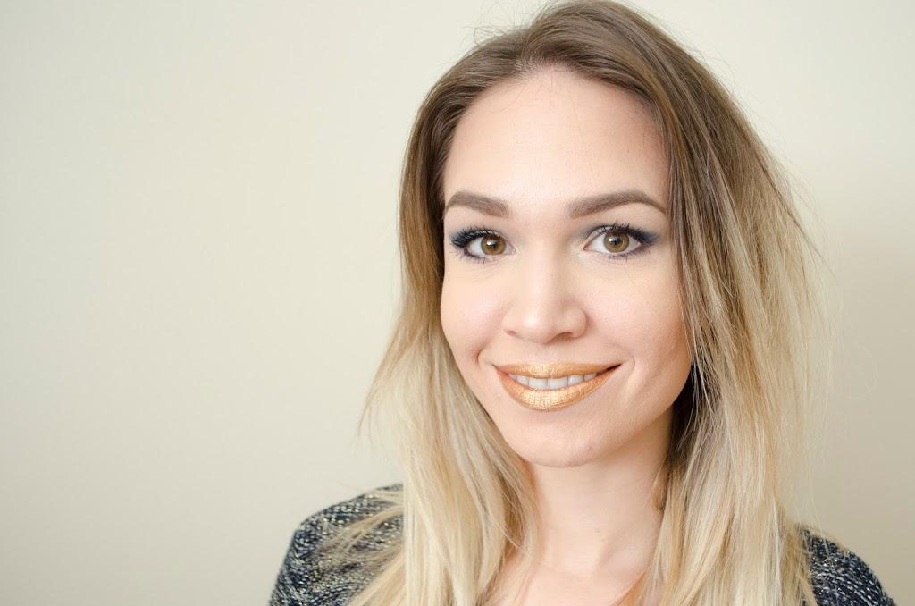 morerebe demonstrating Ofra Liquid Lipstick in Fifth Ave, a yellow gold metallic liquid lipstick